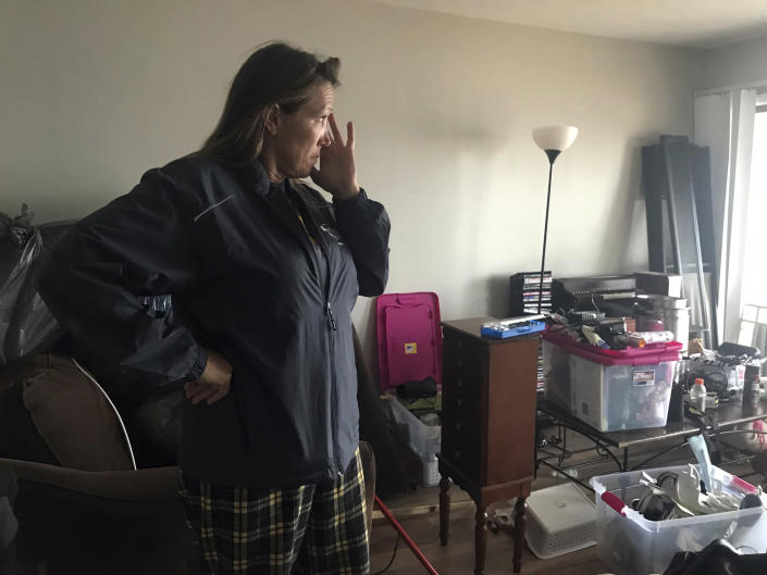 This Oct. 23, 2018 photo shows Regina Ferrell, a fourth grade teacher in Panama City, inside her damaged condo in Panama City, Fla. Since Hurricane Michael swept through the area, many teachers like Ferrell are sleeping in half-destroyed homes, living in cars or staying in their classrooms. (AP Photo/Tamara Lush)