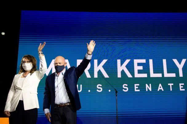 PHOTO: Democratic U.S. Senate candidate Mark Kelly and former Arizona congresswoman Gabrielle Giffords wave to supporters during the Election Night event at Hotel Congress on Nov. 3, 2020, in Tucson, Arizona. (Courtney Pedroza/Getty Images)
