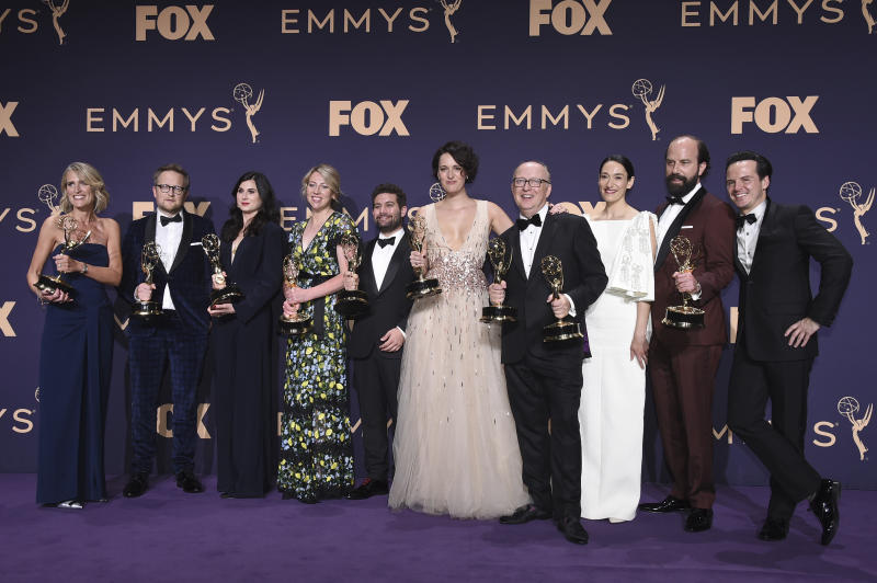 """Harry Bradbeer, fourth from right, winner of the award for outstanding directing for a comedy series, and the cast and crew of """"Fleabag,"""" winners of the award for outstanding comedy series, pose in the press room at the 71st Primetime Emmy Awards on Sunday, Sept. 22, 2019, at the Microsoft Theater in Los Angeles. (Photo by Jordan Strauss/Invision/AP)"""