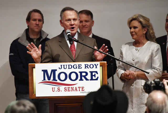GOP Senate candidate Roy Moore, with his wife, Kayla, addresses an election-night party Dec. 12 in Montgomery, Ala. (Photo: Mike Stewart/AP)
