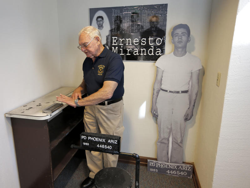 Retired Phoenix Police Capt. Carroll Cooley demonstrates Wednesday, March 13, 2013 at the Phoenix Police Museum in Phoenix, how Ernesto Miranda was fingerprinted 50 years ago today on the same fingerprinting device used on Miranda. Cooley was the arresting officer in the landmark self-incrimination case that reached the Supreme Court and resulted in Miranda Rights that law enforcement uses when arresting a suspect. (AP Photo/Matt York)