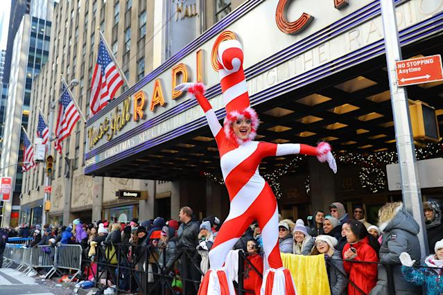 <p>A performer dressed as a candy cane gestures while entertaining the crowd along the parade route in the 91st Macy's Thanksgiving Day Parade in New York, Nov. 23, 2017. (Photo: Gordon Donovan/Yahoo News) </p>