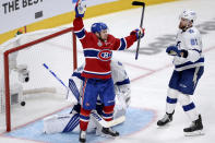 Montreal Canadiens' Artturi Lehkonen (62) celebrates a goal by teammate Alexander Romanov (not shown) as Tampa Bay Lightning's Erik Cernak (81) and Andrei Vasilevskiy (88) look on during the third period of Game 4 of the NHL hockey Stanley Cup final in Montreal, Monday, July 5, 2021. (Ryan Remiorz/The Canadian Press via AP)