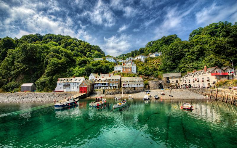 The South West Coast Path, Britain's longest footpath, traces the both coasts of Devon, offering easy access to wild and windswept cliffs, secluded sandy coves and remote hamlets. Pictured above is the village of Clovelly - RolfSt