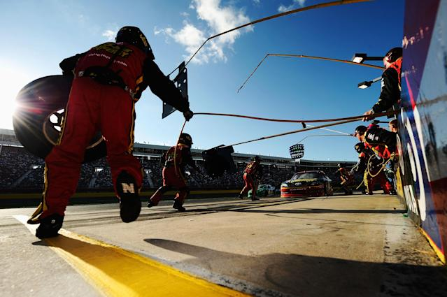 CONCORD, NC - MAY 27: Clint Bowyer, driver of the #15 5-hour Energy Toyota, pits during the NASCAR Sprint Cup Series Coca-Cola 600 at Charlotte Motor Speedway on May 27, 2012 in Concord, North Carolina. (Photo by Jared C. Tilton/Getty Images for NASCAR)