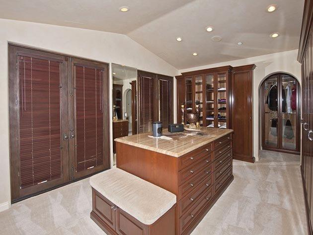 This is a closet. A walk-in closet. One that appears to have a walk-in closet inside of it. Coolest room in the house, unless ...