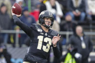 In this photo taken on Saturday, Nov. 2, 2019, Purdue quarterback Jack Plummer (13) throws against Nebraska during the first half of an NCAA college football game in West Lafayette, Ind. (AP Photo/Michael Conroy)