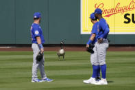 Chicago Cubs outfielders look at a goose standing in center field during the fourth inning of a spring training baseball game against the Arizona Diamondbacks Sunday, March 7, 2021, in Scottsdale, Ariz. The goose, who stayed in the outfield for most of the game, was joined by a second goose in the fifth inning. (AP Photo/Ashley Landis)