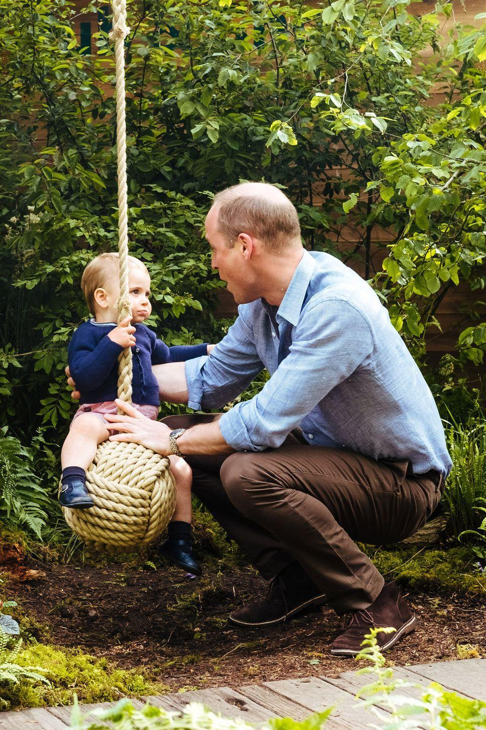 <p>Prince William gives a goofy look at Prince Louis as he pushes him on the swing. </p>