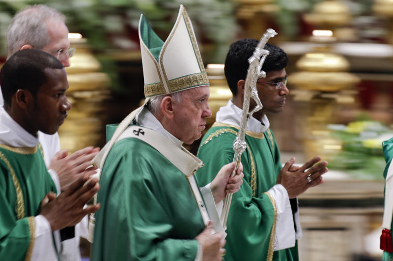 """Pope Francis leaves after celebrating an opening Mass for the Amazon synod, in St. Peter's Basilica, at the Vatican, Sunday, Oct. 6, 2019. Pope Francis urged bishops on Sunday to boldly shake up the status quo as they chart ways to better care for the Amazon and its indigenous peoples, amid threats from forest fires, development and what he called ideological """"ashes of fear"""" that smother God's light. (AP Photo/Andrew Medichini)"""