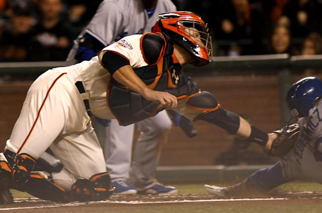 San Francisco Giants' Buster Posey, left, tags out Los Angeles Dodgers' Tim Fedorowicz, right, during the second inning of a baseball game in San Francisco, Thursday, Sept. 26, 2013. (AP Photo/George Nikitin)