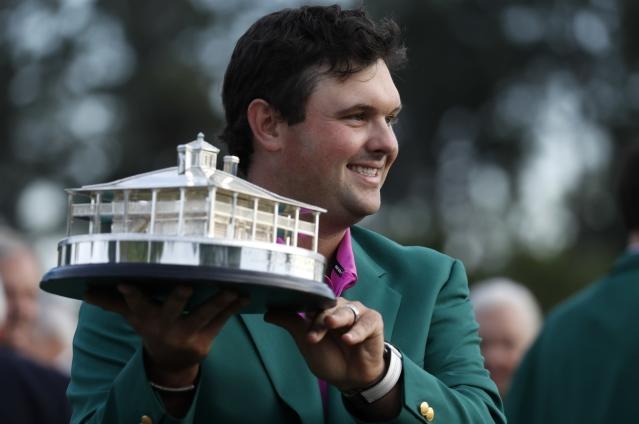 Patrick Reed of the U.S. hold the Masters Tournament Trophy and wears his Green Jacket after winning the 2018 Masters tournament at the Augusta National Golf Club in Augusta, Georgia, U.S. April 8, 2018. REUTERS/Jonathan Ernst