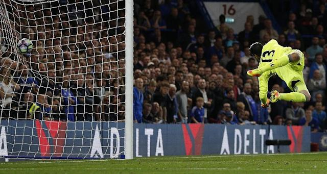 Chelsea goalkeeper Thibaut Courtois dives but fails to save a long-range shot from Liverpool's Jordan Henderson (AFP Photo/Adrian Dennis)