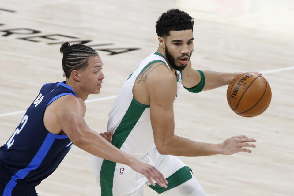 Boston Celtics forward Jayson Tatum (0) goes against Oklahoma City Thunder center Isaiah Roby (22) during the first half of an NBA basketball game Saturday, March 27, 2021, in Oklahoma City. (AP Photo/Garett Fisbeck)