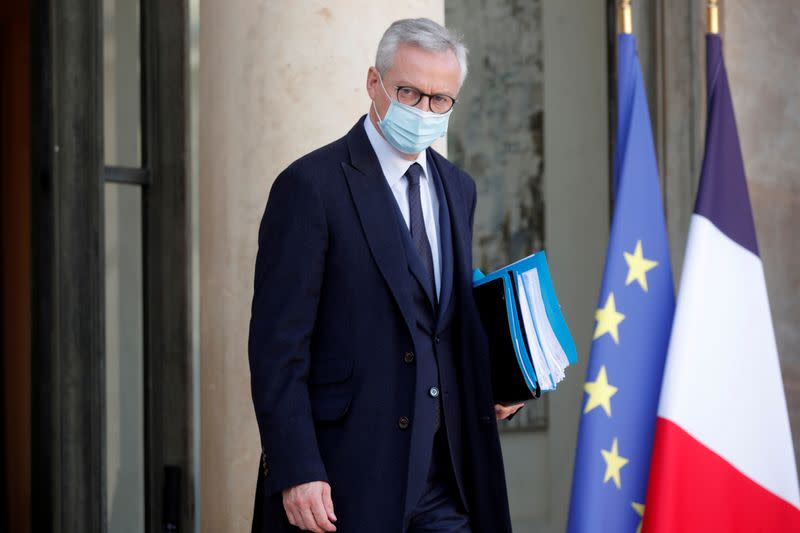 French Finance Minister Bruno Le Maire leaves following the weekly cabinet meeting at the Elysee Palace in Paris