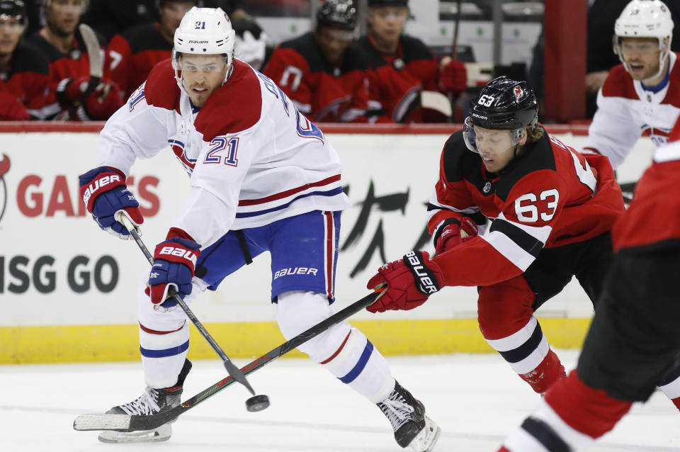 New Jersey Devils left wing Jesper Bratt (63) defends as Montreal Canadiens center Nick Cousins (21) looks to pass the puck during the first period of an NHL hockey game Tuesday, Feb. 4, 2020, in Newark, N.J. (AP Photo/Kathy Willens)
