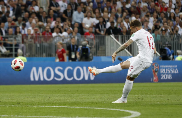 England's Kieran Trippier scores the opening goal during the semifinal match between Croatia and England at the 2018 soccer World Cup in the Luzhniki Stadium in Moscow, Russia, Wednesday, July 11, 2018. (AP Photo/Frank Augstein)