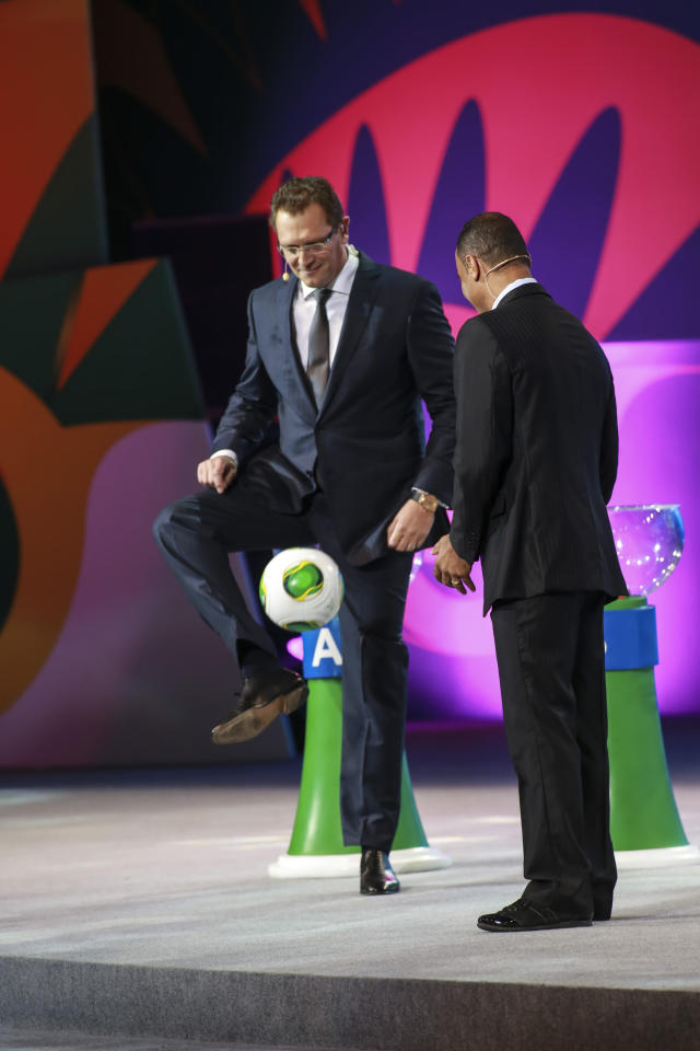 SAO PAULO, BRAZIL - DECEMBER 01: Cafu, Brazilian soccer player and Jerome Valcke play with the ball ?Cafusa? during the Draw for the FIFA Confederations Cup 2013 at Anhembi Convention Center on December 01, 2012 in Sao Paulo, Brazil. (Photo by Alexandre Schneider/LatinContent/Getty Images)