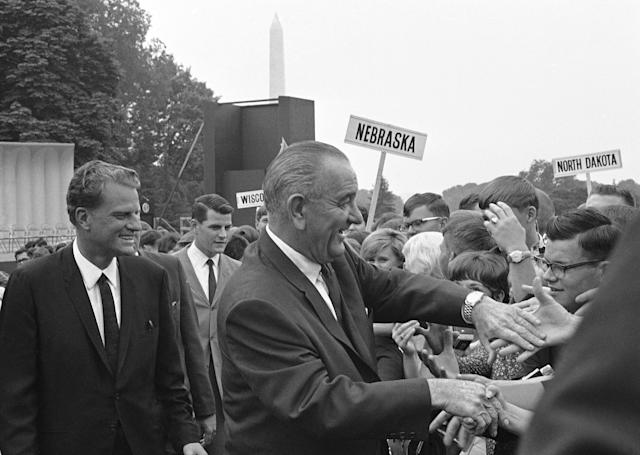 <p>President Lyndon B. Johnson with an old friend, evangelist Billy Graham, at the White House in Washington, D.C., on June 14, 1967. (Photo: Henry Burroughs/AP) </p>