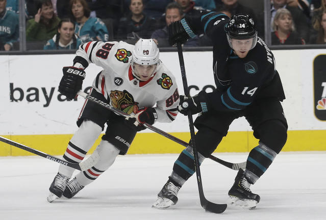 San Jose Sharks center Gustav Nyquist (14) skates in front of Chicago Blackhawks right wing Patrick Kane (88) during the first period of an NHL hockey game in San Jose, Calif., Thursday, March 28, 2019. (AP Photo/Jeff Chiu)