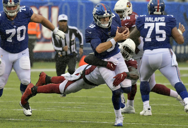 Arizona Cardinals' Chandler Jones, bottom, brings down New York Giants quarterback Daniel Jones (8) during the second half of an NFL football game, Sunday, Oct. 20, 2019, in East Rutherford, N.J. (AP Photo/Bill Kostroun)
