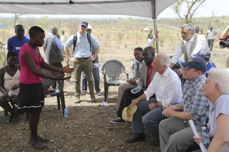 """<p> In this photo taken on Friday April 14, 2017, U.S Senators Bob Corker, third right, and Chris Coons, second right, listen to a South Sudanese refugee during a group discussion at the Bidi Bidi refugee settlement in northern Uganda. In a political climate dominated by President Donald Trump's slogan of """"America First,"""" two U.S. senators are proposing making American food aid more efficient after meeting with victims of South Sudan's famine and civil war. After visiting the world's largest refugee settlement in northern Uganda, Democratic Sen. Chris Coons of Delaware told The Associated Press that the U.S. """"can deliver more food aid at less cost"""" through foreign food aid reform. (AP/Photo/Justin Lynch) </p>"""