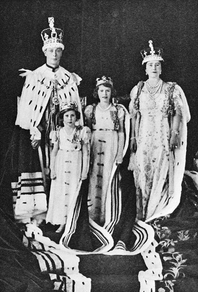 <p>After his brother abdicates the throne, the Duke of York becomes King George VI. Here, we see His Royal Highness with Queen Elizabeth and Princesses Elizabeth and Margaret on Coronation Day.</p>