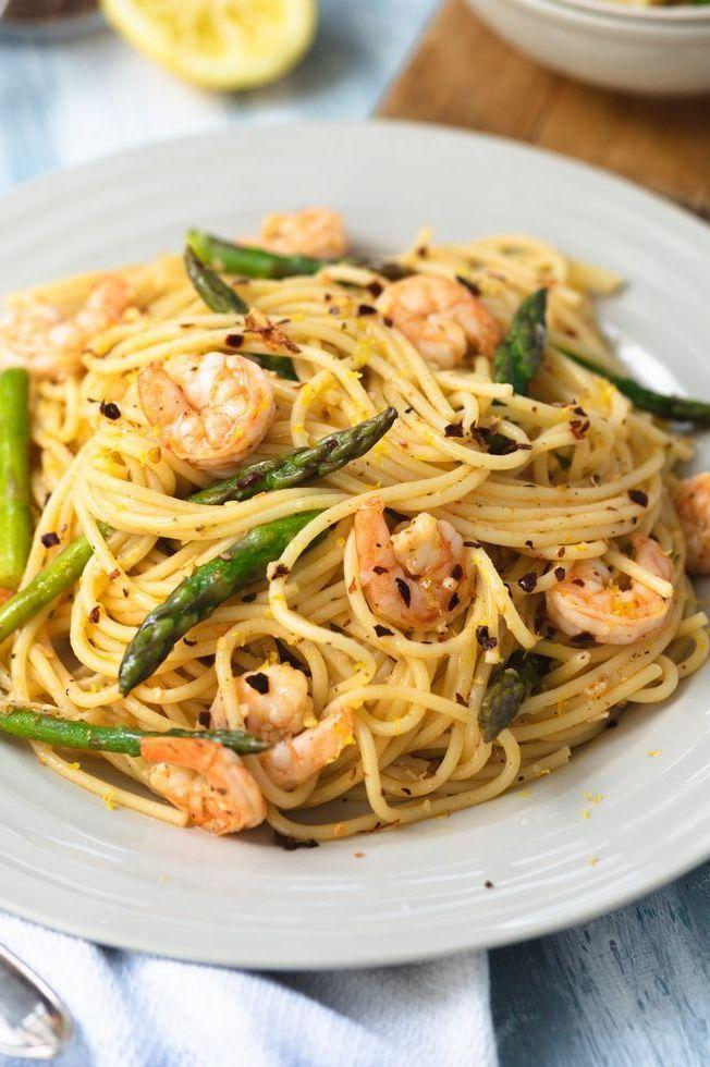 """<p>Prawn linguine with <a href=""""https://britishasparagus.com/"""" rel=""""nofollow noopener"""" target=""""_blank"""" data-ylk=""""slk:British asparagus"""" class=""""link rapid-noclick-resp"""">British asparagus</a> and delicious garlic buttery sauce = Heaven. This'll soon become your go-to <a href=""""https://www.delish.com/uk/pasta-recipes/"""" rel=""""nofollow noopener"""" target=""""_blank"""" data-ylk=""""slk:pasta"""" class=""""link rapid-noclick-resp"""">pasta</a> dish for <a href=""""https://www.delish.com/uk/cooking/recipes/g32768299/easy-dinner-recipes/"""" rel=""""nofollow noopener"""" target=""""_blank"""" data-ylk=""""slk:weeknight dinners"""" class=""""link rapid-noclick-resp"""">weeknight dinners</a>. </p><p>Get the <a href=""""https://www.delish.com/uk/cooking/recipes/a36208799/prawn-linguine/"""" rel=""""nofollow noopener"""" target=""""_blank"""" data-ylk=""""slk:Garlic Butter Prawn Linguine"""" class=""""link rapid-noclick-resp"""">Garlic Butter Prawn Linguine</a> recipe.</p>"""