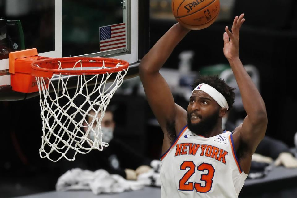 New York Knicks' Mitchell Robinson dunks during the second half of an NBA basketball game against the Boston Celtics, Sunday, Jan. 17, 2021, in Boston. (AP Photo/Michael Dwyer)