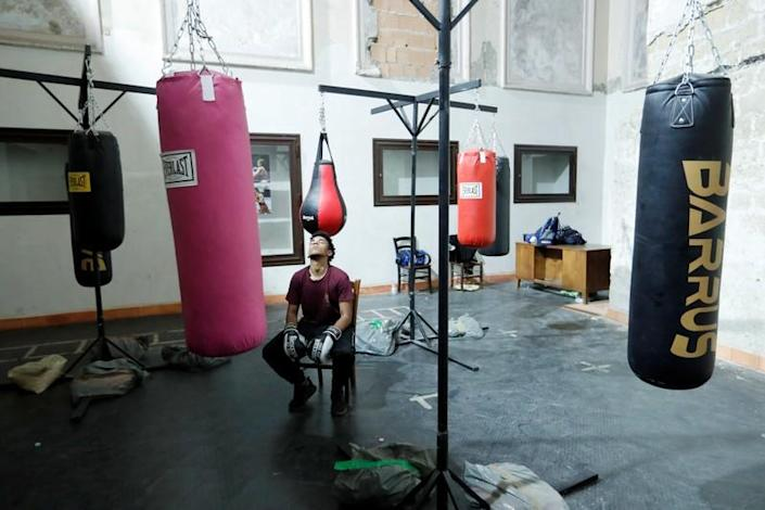 Nico Rodrigues, 21, pauses during a boxing class at the Santa Maria della Sanita Basilica in the Rione Sanita neighbourhood in Naples