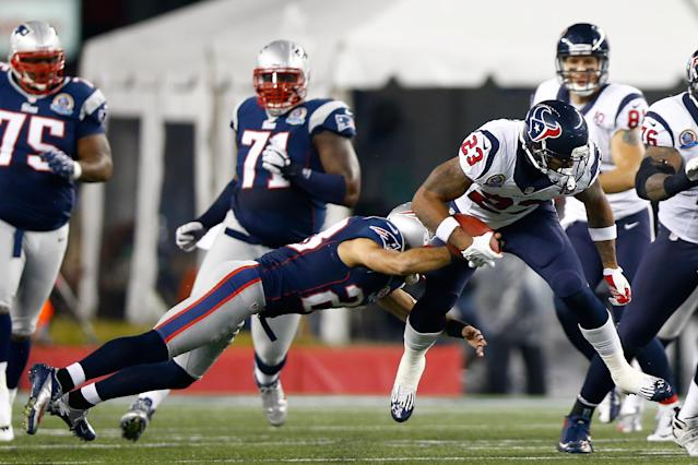 FOXBORO, MA - DECEMBER 10: Running back Arian Foster #23 of the Houston Texans runs the ball as he is hit by strong safety Steve Gregory #28 of the New England Patriots in the first half at Gillette Stadium on December 10, 2012 in Foxboro, Massachusetts. (Photo by Jared Wickerham/Getty Images)