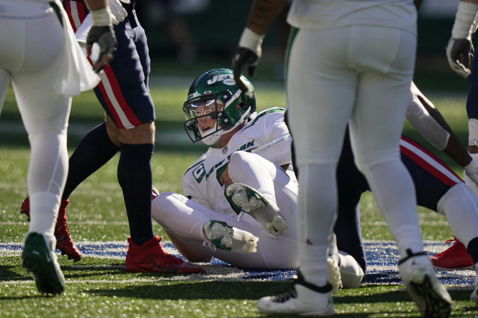 New York Jets quarterback Zach Wilson gets up after being sacked during the second half of an NFL football game against the New England Patriots, Sunday, Sept. 19, 2021, in East Rutherford, N.J. (AP Photo/Frank Franklin II)