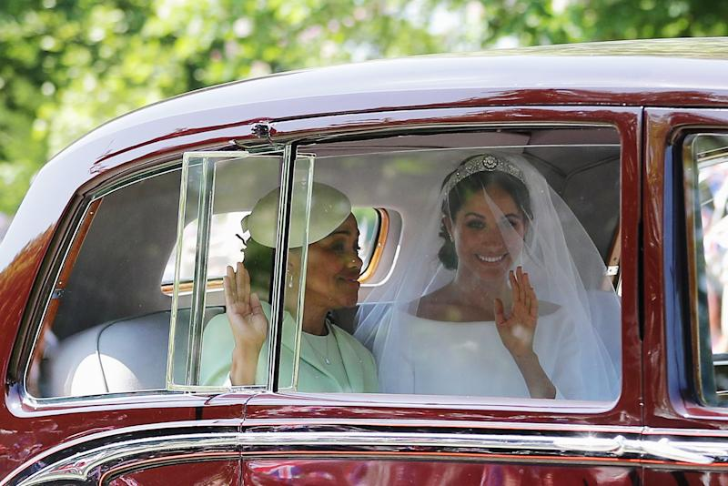 Meghan Markle (R) with her mother Doria Ragland drive down the Long Walk as they arrive at Windsor Castle ahead of her wedding to Prince Harry on May 19, 2018 in Windsor, England.