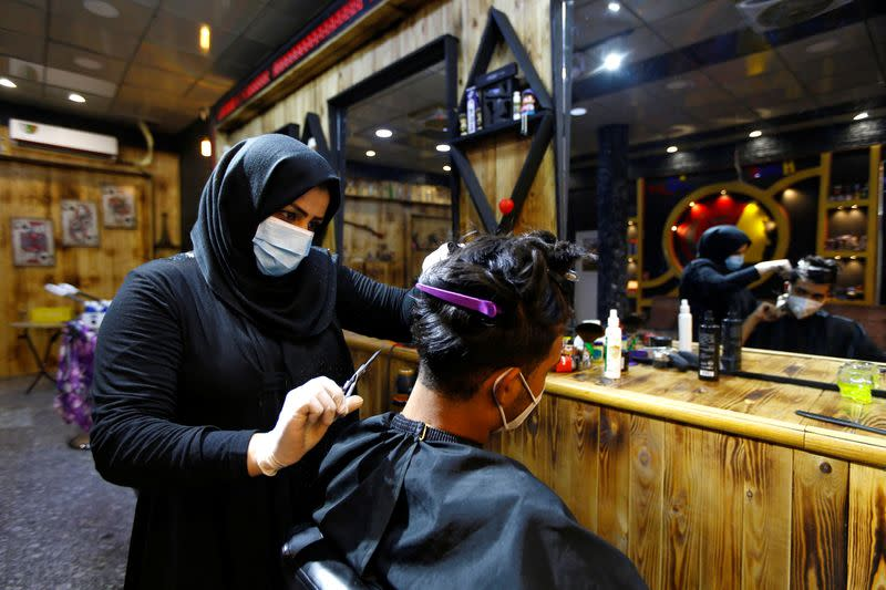 First woman to cut men's hair makes waves in Babylon