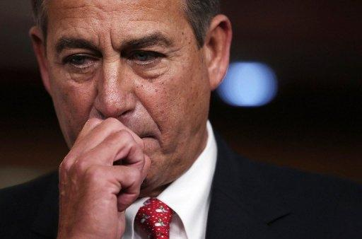 <p>House Speaker John Boehner pauses while speaking during a press conference December 21, 2012.</p>