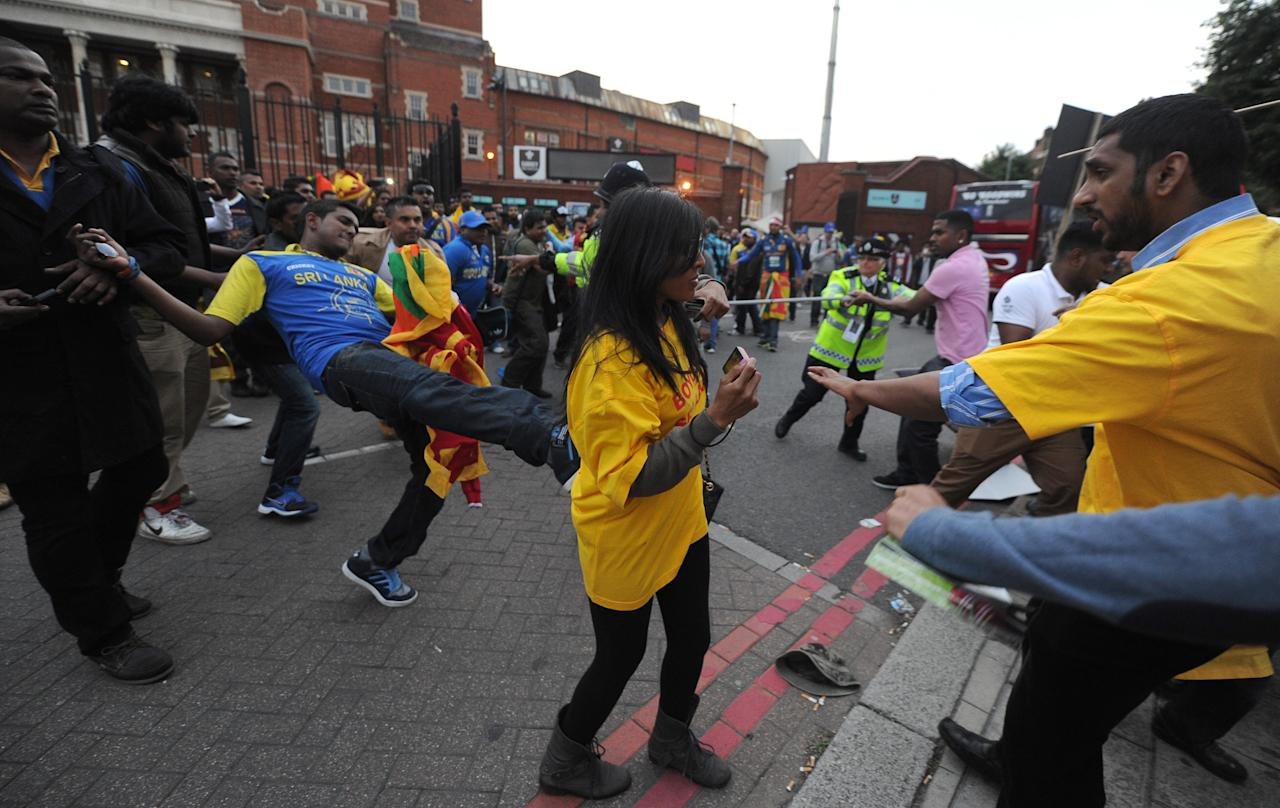 Sri Lankan cricket fans clash with police and demonstrators from the Expel Sri Lanka From The Commonwealth protest group following the ICC Champions Trophy match at The Oval, London.