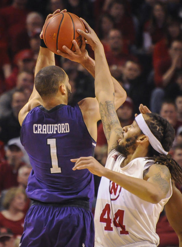 Nebraska's Terran Petteway (44) blocks a shot by Northwestern's Drew Crawford (1) during an NCAA college basketball game Saturday, March 1, 2014, in Lincoln, Neb. (AP Photo/Dave Weaver)