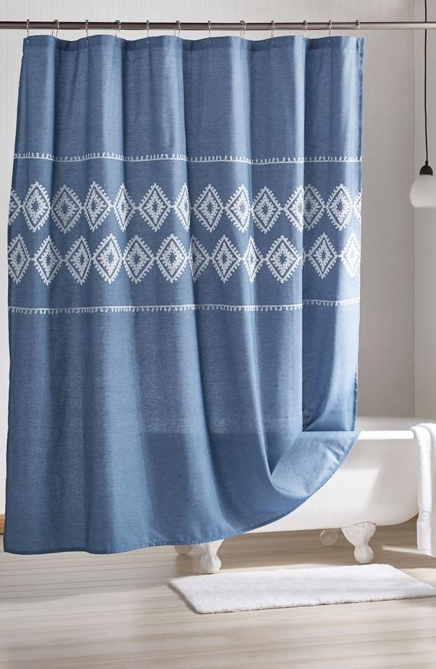 "$26, Nordstrom. <a href=""https://shop.nordstrom.com/s/peri-home-geo-embroidered-chambray-shower-curtain/5274678?origin=category-personalizedsort&breadcrumb=Home%2FAnniversary%20Sale%2FHome&color=blue"">Get it now!</a>"