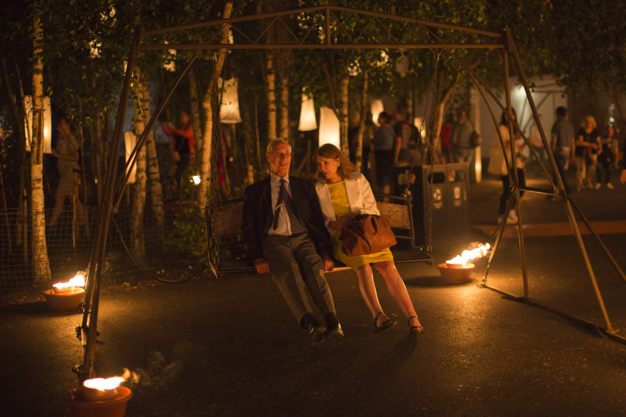 <p>A couple enjoy a swing as installations are lit in front of Tate Modern as part of the 'Fire Garden' event by Compagnie Carabosse in London, England. The event forms part of the 'London's Burning' festival which commemorates the Great Fire of London. (Dan Kitwood/Getty Images)<br /></p>