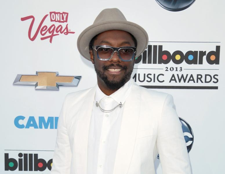 """FILE - In this May 19, 2013 photo, Will.i.am arrives at the Billboard Music Awards at the MGM Grand Garden Arena in Las Vegas. Will.i.am says his """"I AM"""" trademark is too similar to one Pharrell's company tried to register. (Photo by John Shearer/Invision/AP, File)"""