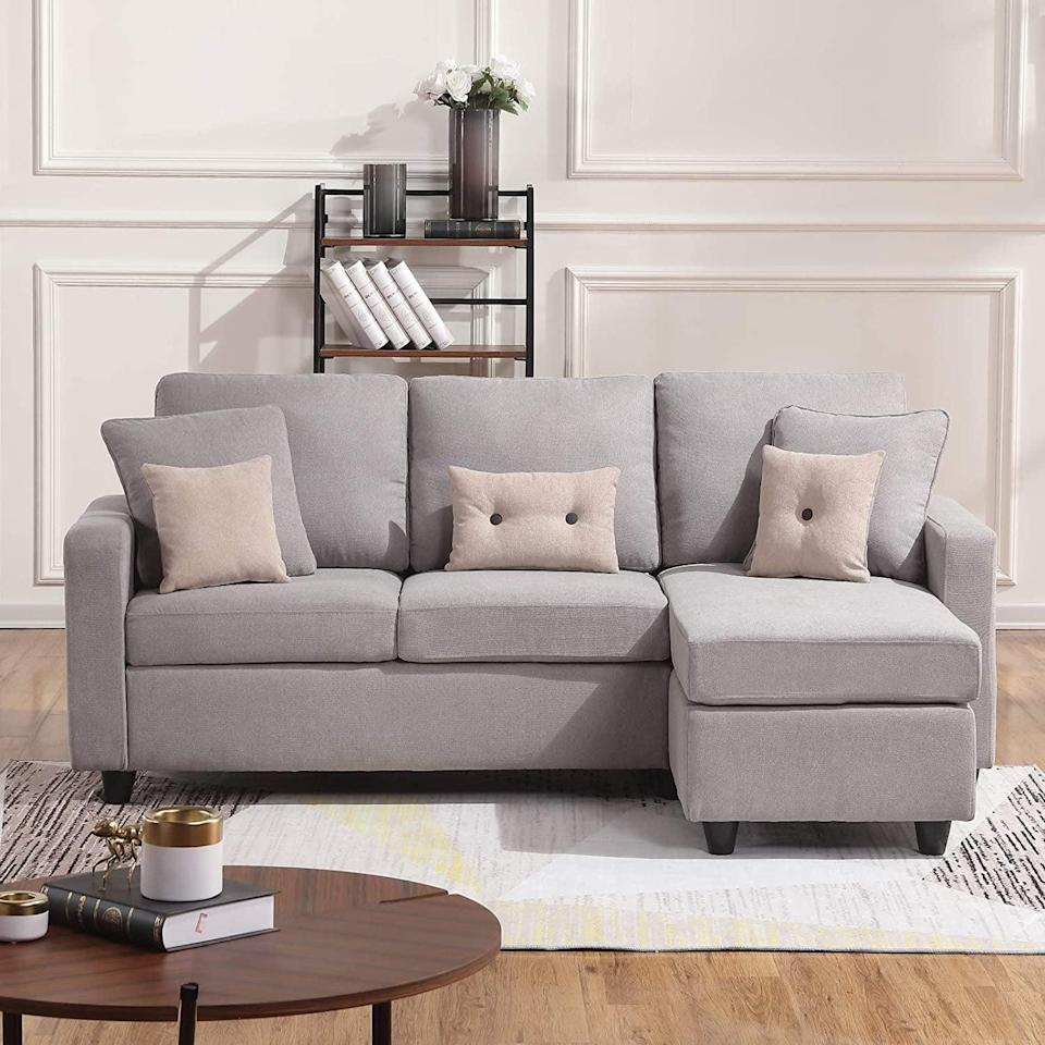 <p>If you have a more neutral space, opt for the <span>Honbay Convertible Sectional Sofa</span> ($290) in light gray.</p>