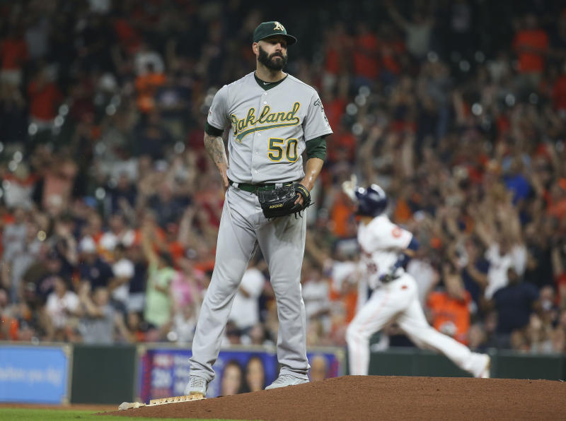 Sep 9, 2019; Houston, TX, USA; Oakland Athletics starting pitcher Mike Fiers (50) reacts and Houston Astros catcher Robinson Chirinos (28) rounds the bases after hitting a home run during the first inning at Minute Maid Park. Mandatory Credit: Troy Taormina-USA TODAY Sports