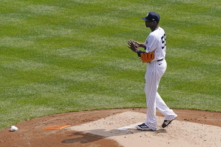New York Yankees starting pitcher Domingo German reacts during the second inning of a baseball game against the Toronto Blue Jays, Sunday, April 4, 2021, at Yankee Stadium in New York. German gave up a solo home run and a two-run blast to Blue Jays hitters. (AP Photo/Kathy Willens)