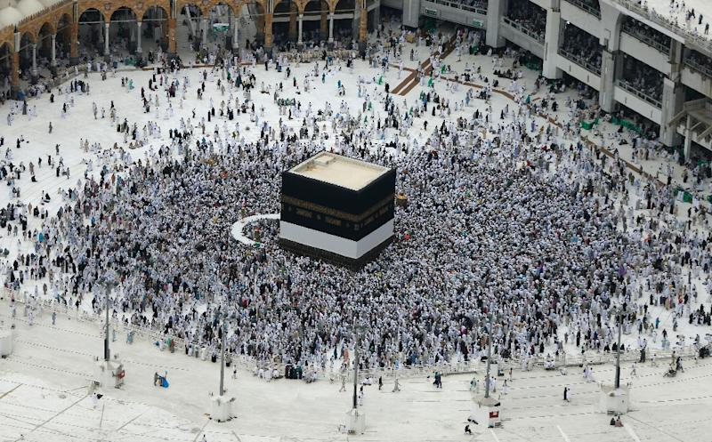 Muslim pilgrims circle the Kaaba at the Grand Mosque in the Saudi city of Mecca