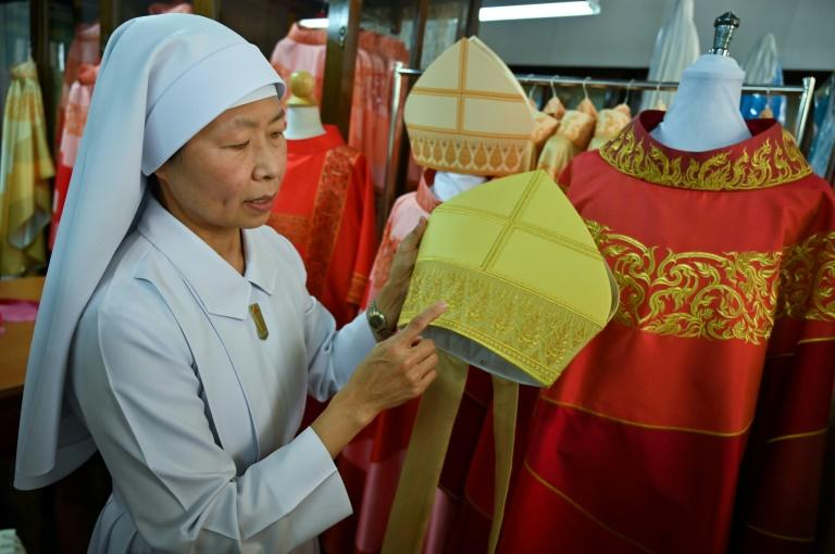 About a dozen seamstresses have been working long days for two months on the more than 200 robes, many stacked neatly in the convent next to round handmade hats (AFP Photo/Romeo GACAD)