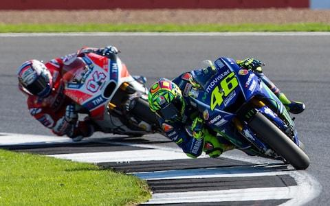 Movistar Yamaha MotoGP MotoGP rider Valentino Rossi is chased down by Ducati Team MotoGP rider Andrea Dovizioso - Credit: Tim Williams/Action Plus/Getty Images