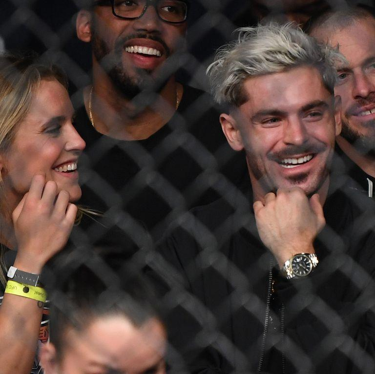 "<p>When Efron attended a UFC 235 match in Las Vegas with Danish Olympic swimmer <a href=""https://www.elle.com/culture/celebrities/a26752605/who-is-sarah-bro-zac-efron-girlfriend/"" rel=""nofollow noopener"" target=""_blank"" data-ylk=""slk:Sarah Bro"" class=""link rapid-noclick-resp"">Sarah Bro</a> back in March 2019, fans began to speculate the two were dating. In the time after the rumors first circulated, though, the couple maintained a low-profile. Efron has since <a href=""https://www.elle.com/culture/celebrities/a30700367/zac-efron-dating-halston-sage/"" rel=""nofollow noopener"" target=""_blank"" data-ylk=""slk:been linked"" class=""link rapid-noclick-resp"">been linked</a> to his <em>Neighbors </em>co-star <a href=""https://www.elle.com/culture/celebrities/a30700656/who-is-halston-sage-zac-efron-girlfriend/"" rel=""nofollow noopener"" target=""_blank"" data-ylk=""slk:Halston Sage"" class=""link rapid-noclick-resp"">Halston Sage</a>.</p>"