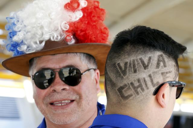 Chile soccer fans arrive at Cuiaba airport June 11, 2014, prior to the 2014 World Cup Group B match between Chile and Australia on June 13. REUTERS/Eric Gaillard (BRAZIL - Tags: SOCCER SPORT WORLD CUP)