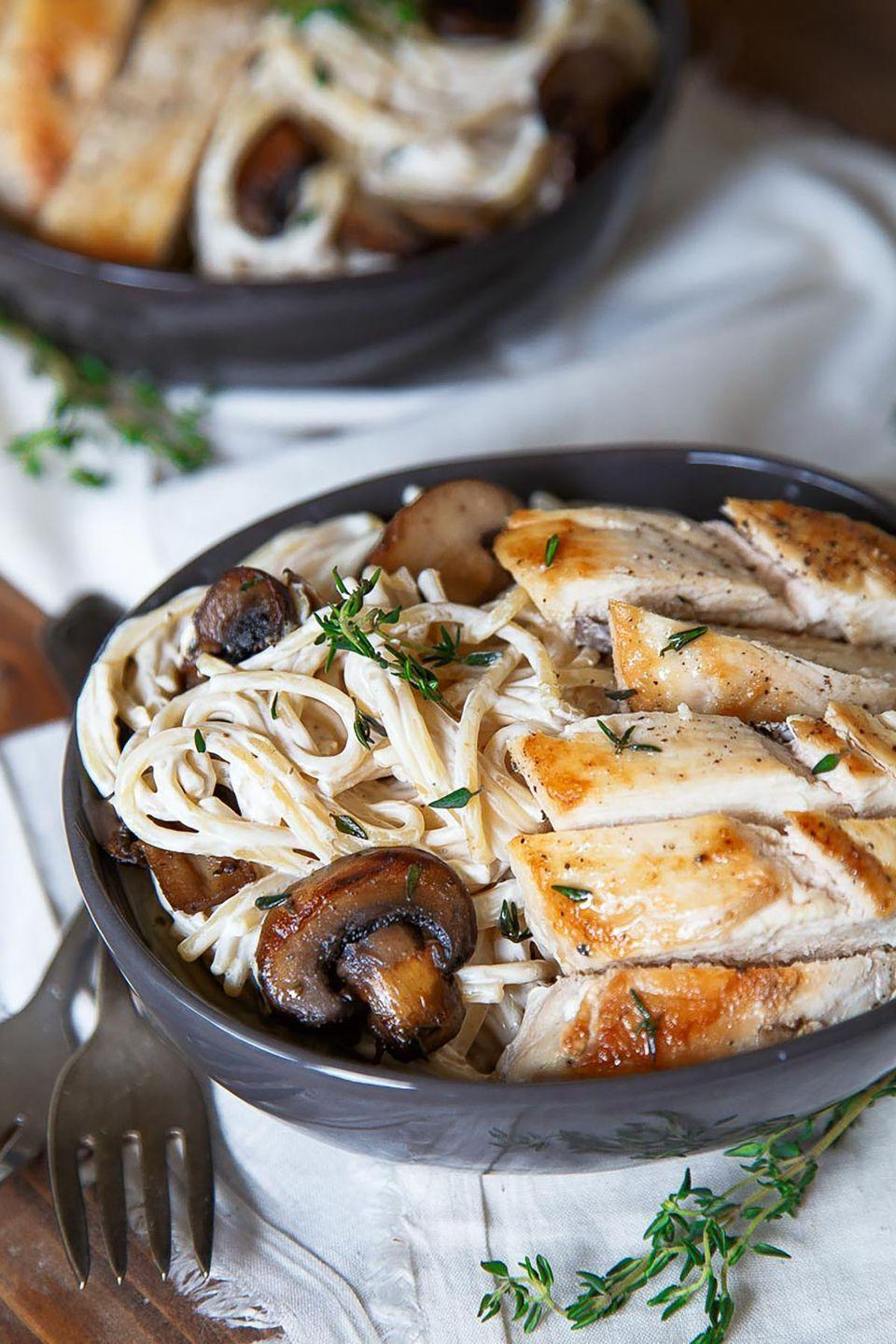 """<p>Creamy pasta, mushrooms, and """"engagement"""" chicken are a winning combination, whether you're waiting on that magic question or long married.</p><p><strong>Get the recipe at <a href=""""http://www.dessertfortwo.com/dinner-for-two-engagement-pasta/"""" rel=""""nofollow noopener"""" target=""""_blank"""" data-ylk=""""slk:Dessert for Two"""" class=""""link rapid-noclick-resp"""">Dessert for Two</a>.</strong> </p>"""