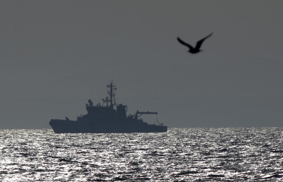 FILE - In this file photo dated Monday, Feb. 29, 2016, EU Frontex vessel Merikarhu, patrols on the Aegean Sea, between the eastern Greek Island of Agathonisi and the nearby Turkish shores. European Union court of auditors say the bloc's border and coast guard agency Frontex is unable to fulfil its duties to combat unauthorized migration and cross-border crime. (AP Photo/Lefteris Pitarakis, FILE)
